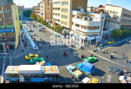 TEHRAN, IRAN - OCTOBER 24, 2017:  The fast and chaotic traffic on the intersection of Amir Kabir and Pamenar streets, on October 24 in Tehran. - Stock Photo