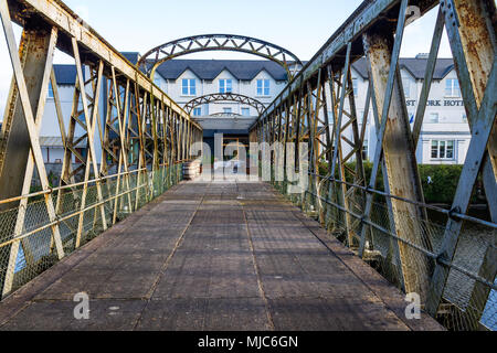 metal railway bridge now being used as an approach and outdoor eating and drinks area for a large hotel in skibbereen, ireland. - Stock Photo