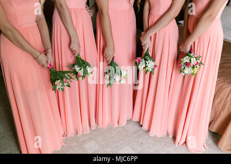 Beautiful bridesmaids with bouquets in home. Beauty model girls in a colorful wedding dresses. five people - Stock Photo