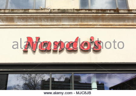 A Nando's Sign Above The Restaurant In Piccadilly Gardens Manchester City Centre Manchester England May 2018 - Stock Photo