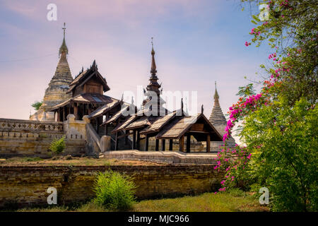 Beautiful view of ancient temple in old Bagan with flowers foreground, Myanmar, Burma - Stock Photo