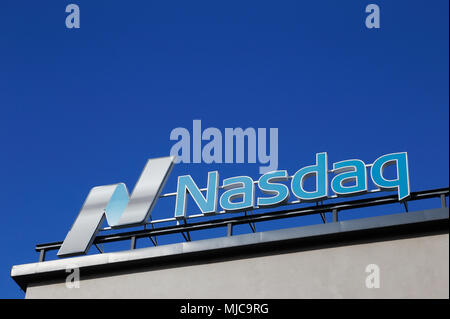 Stockholm, Sweden - July 4, 2016: Close up of the Nasdaq roof sign at the office in Stockholm at the Tullvaktsvagen street against the blue sky. - Stock Photo