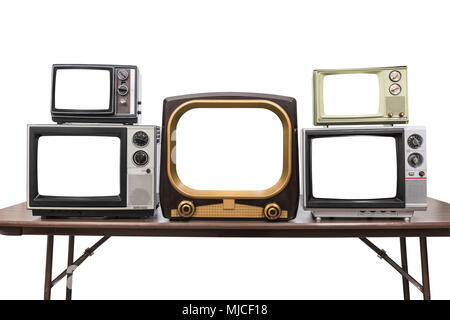 Five vintage televisions isolated on white with empty screens and clipping path. - Stock Photo