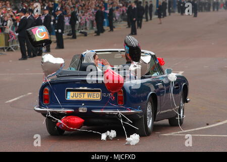 UK - Royal Wedding of Prince William and Kate (Catherine) Middleton - newlyweds William and Kate driving in an open top vintage Aston Martin Volante car along the Mall from  Buckingham Palace 29th April 2011 London UK - Stock Photo