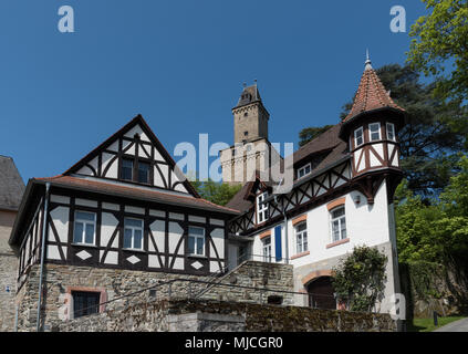 View on half timbered houses and castle tower in the historic old town of Kronberg im Taunus, Hesse, Germany
