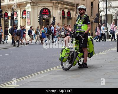 NHS London Ambulance Paramedic on a bicycle in London, UK. 2018. - Stock Photo