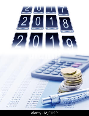 annual accounts, annual balance, electronic calculator and calendar - Stock Photo