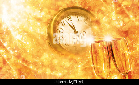 Greetings card, New Year 2019, sparkling wine and clock - Stock Photo