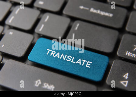 Multi language translation concept: blue computer button closeup with translate text on keyboard. - Stock Photo