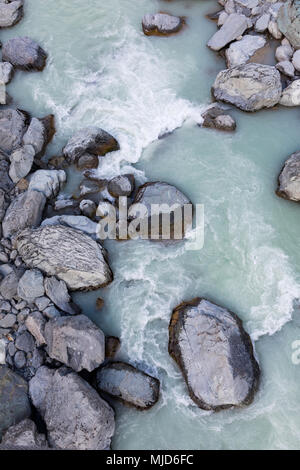 Overhead view of alpine rocks and stream with glacial water, Mount Cook Aoraki National Park, New Zealand - Stock Photo