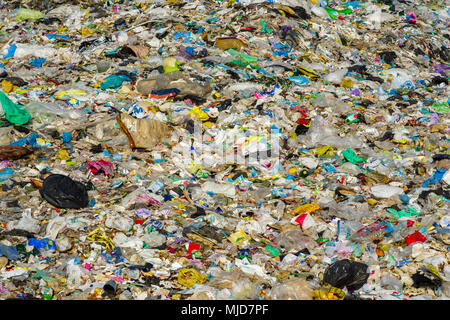 garbage bags and plastic bottles and other polyethylene labels and packages at the city dump