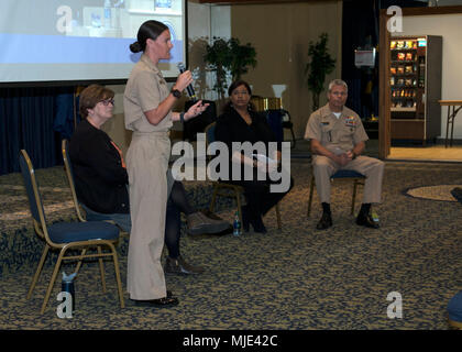 PANAMA CITY, Florida - Navy Experimental Diving Unit Research Psychologist Lt. Jenna Jewell, USN, answers questions during a 2018 Women's History Month panel session held March 13, 2018 in Panama City, Florida. The event, hosted by Naval Surface Warfare Center Panama City Division, featured leadership videos that focused on the importance of diversity, inclusion, and embracing change for recruiting and retention purposes. U.S. Navy - Stock Photo