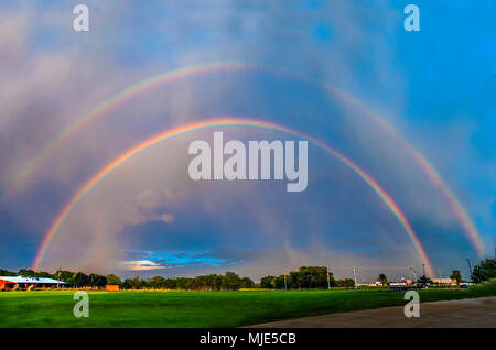 BOSSIER CITY, LA., U.S.A. - APRIL 13, 2018: A double rainbow forms in the east as a storm approaches from the west. - Stock Photo