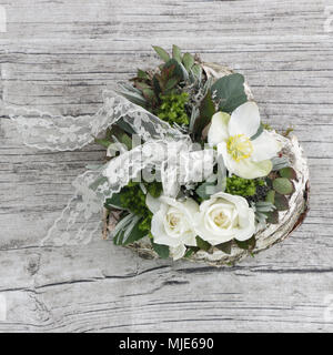 Heart 'winter magic' with white roses and Christmas rose - Stock Photo