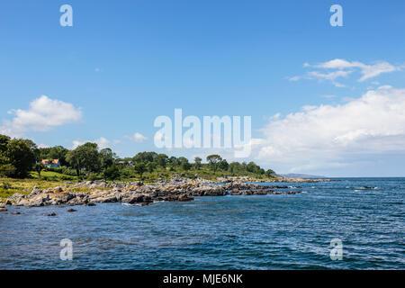 The coast at Bølshavn, in the background Gudhjem, Europe, Denmark, Bornholm, Bølsbakke, - Stock Photo