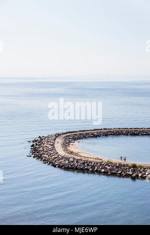 Bathers at the pier of Vang, former port of debarkation of the granite quarry, Europe, Denmark, Bornholm, - Stock Photo