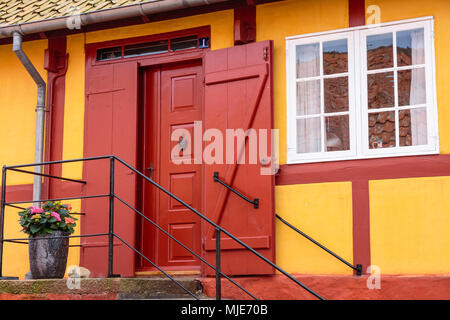 Yellow-red half-timbered house in the old town of Svaneke, Europe, Denmark, Bornholm, - Stock Photo