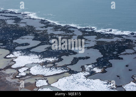 Iceland's south coast between Eyrarbakki and Stokkseyri close Selfoss, photographed from a Cessna, partially snow covered, - Stock Photo