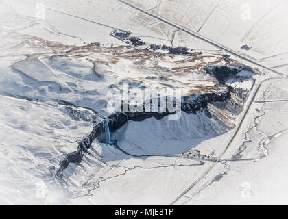 Seljalandsfoss waterfall in the winter, aerial shot from a Cessna - Stock Photo