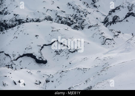 Iceland, bird's eye view, in winter, snow-covered lava fields - Stock Photo