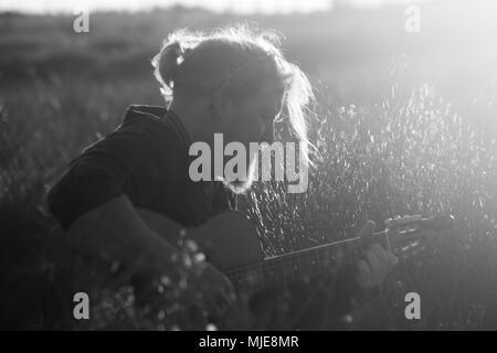Man plays guitar - Stock Photo
