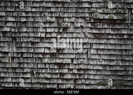 old shingles, grey and weathered on a wooden house in the Black Forest, detail - Stock Photo