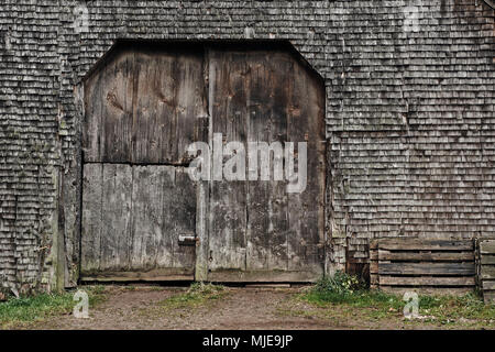old shingles and gate, grey and weathered on a wooden house in the Black Forest, detail - Stock Photo