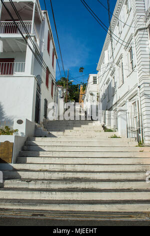 Stairs lerading up the hill between historic houses in Charlotte Amalie capital of St. Thomas, US Virgin Islands - Stock Photo