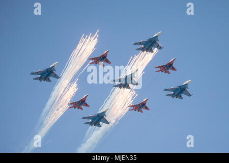 Moscow, Russia. 4th May, 2018. Russian Air Force multi-purpose fighters Su-30SM of the pilot group Russkiye Vityazi (Russian Knights) and MiG-29 of the Strizhi (Swifts) aerobatic team fly in formation during a rehearsal of the upcoming Victory Day air show marking the 73rd anniversary of the victory over Nazi Germany in the 1941-45 Great Patriotic War, the Eastern Front of World War II. Credit: Victor Vytolskiy/Alamy Live News - Stock Photo