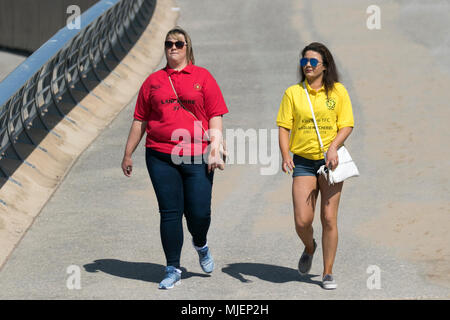 Holidaymakers & Tourists in Blackpool Lancashire. UK Weather. 5th May, 2018.  Sunny start to the day on the Fylde Coast as the north-west coast experiences  the hottest temperatures so far this week. Credit: MediaWorldImages/AlamyLiveNews - Stock Photo