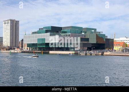 Copenhagen, Denmark. 5th May, 2018. The BLOX building, a new prestige building for architecture and design on Christians Brygge at the waterfront at Frederiksholm Canal next to the Black Diamond in the inner harbour. The building also houses the Danish Architecture Centre and a number of companies working with future solutions for cities. The building was inaugurated by H.M. Queen Margrethe II yesterday - today open house to a festive opening day. BLOX is the original name of the old brew-house property where it is situated. Architects OMA. Credit: Niels Quist/Alamy Live News - Stock Photo