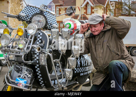 Troon, Ayrshire, UK. 5th May, 2018. Over 100 scooters, riders and passengers attended the annual Scottish Mod Rally in Troon, one of the largest Mod meetings in Scotland with scooters coming from all across the country. Before the final customary 'Ride out' through the town, there were competitions and prizes for the best vintage, best presented and furthest travelled scooters when the owners take pride in presenting their scooters and themselves in best order. Picture of BILLY CLARK from Stepps, Glasgow with his 'Madness' Vespa PX125 Credit: Findlay/Alamy Live News - Stock Photo