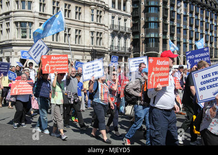 London, UK. 5th May, 2018. Pro-life demonstrators march through London Credit: Alex Cavendish/Alamy Live News - Stock Photo