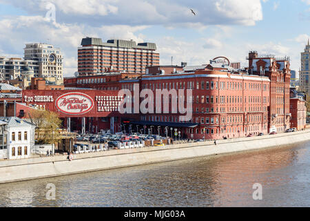 Moscow, Russia - April 27, 2018: Former factory building Red October confectionery on Bersenevskaya embankment - Stock Photo
