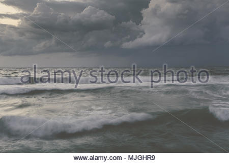 Storm in ocean with big windy waves Northeast Atlantic Coast enhanced sky toned - Stock Photo