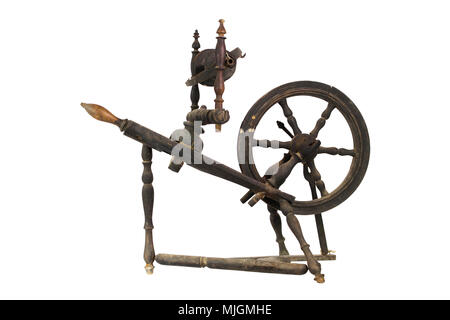 Spinning Wheel For Making Yarn From Wool Fibers. Vintage Rustic Equipment - Stock Photo