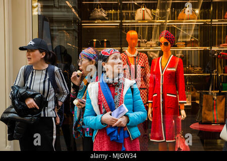 Moscow, Russian Federation- April 30, 2018 Foreign women tourists walk around the trading house GUM. - Stock Photo