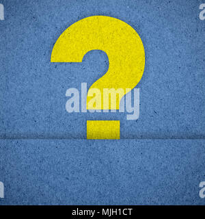 question mark symbols on blue paper texture - Stock Photo