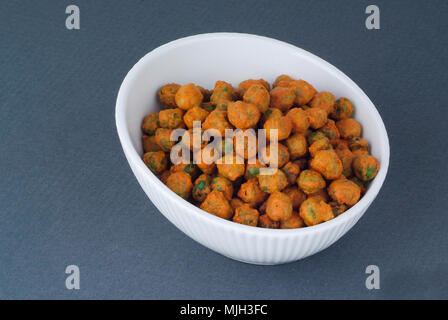 Nuts in bowl on dark grey background. - Stock Photo