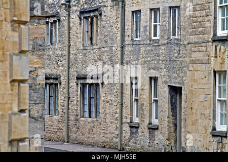 Charismatic local housing built from Cotswold limestone in Cirencester's Coxwell Street. - Stock Photo