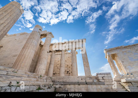 Monumental gateway called Propylaea, entrance to the top of Acropolis of Athens city, Greece. Temple of Athena Nike on right - Stock Photo