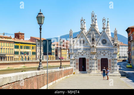 Santa Maria della Spina, a small church in the Italian city of Pisa, is located on the bank of river Arno - Stock Photo