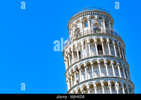 Leaning tower of Pisa, Italy against a cloudless blue sky - Stock Photo