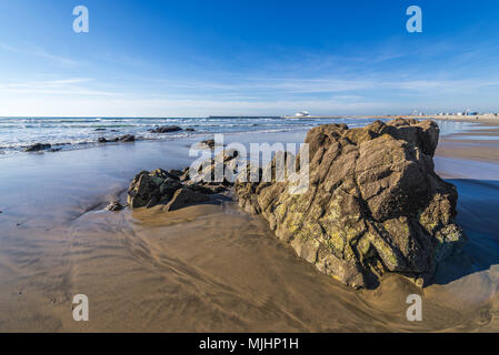Rocks on the beach of Nevogilde civil parish in Porto, second largest city in Portugal - Stock Photo