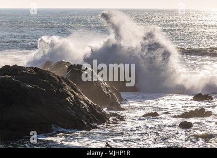 Waves crashing on rocks of Atlantic Ocean shore, view from Molhe beach in Nevogilde civil parish of Porto, second largest city in Portugal - Stock Photo