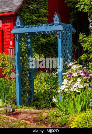 Beautiful rustic arbor in a country garden. - Stock Photo