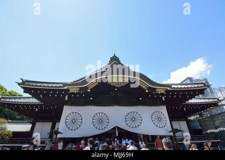 People praying at Yasukuni shrine in Tokyo, Japan. This shrine is a famous tourist spot in Tokyo - Stock Photo