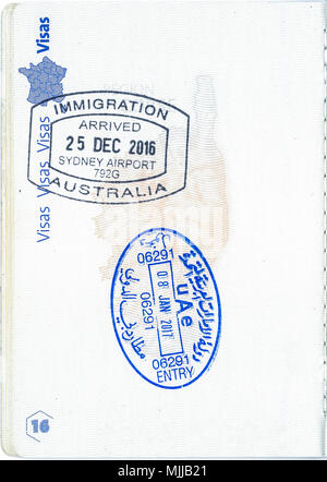 Stamps of Australia and the United Arab Emirates in a French passport. Personal data removed - Stock Photo