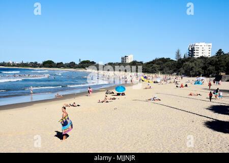 CROWDS OF PEOPLE ENJOYING BEAUTIFUL MOOLOOLABA BEACH IN QUEENSLAND AUSTRALIA - Stock Photo