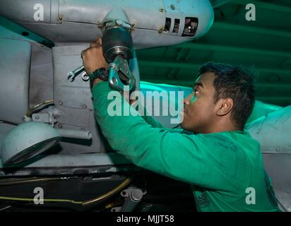 171201-N-OA516-0054 ATLANTIC OCEAN (Dec. 1, 2017) Aviation Machinist Mate 3rd Class Anthony Toch from Camden, New Jersey, and assigned to Helicopter Sea Combat Squadron 28 removes a rescue hoist panel on an MH-60S Sea Hawk in the hangar bay of the amphibious assault ship USS Iwo Jima (LHD 7). Iwo Jima, components of the Iwo Jima Amphibious Ready Group and the 26th MEU are conducting a Combined Composite Training Unit Exercise that is the culmination of training for the Navy-Marine Corps team and will certify them for deployment. (U.S. Navy photo by Mass Communication Specialist 3rd Class Kevin - Stock Photo